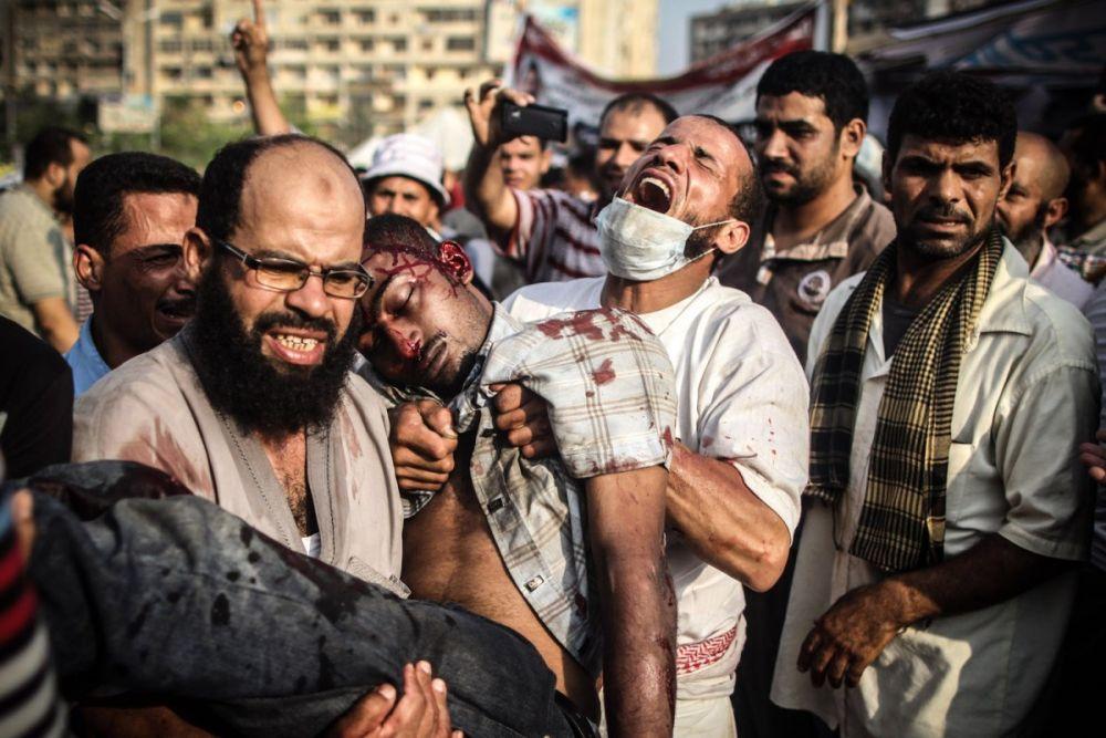 Июльские столкновения демонстрантов с сотрудниками службы безопасности в Каире. Фото: Mosa'ab Elshamy, Anadolu Agency