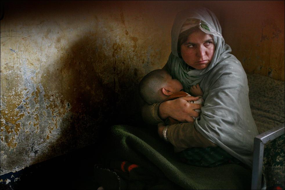 Мать с ребенком. Фото - Дэвид Гуттенфельдер (David Guttenfelder)